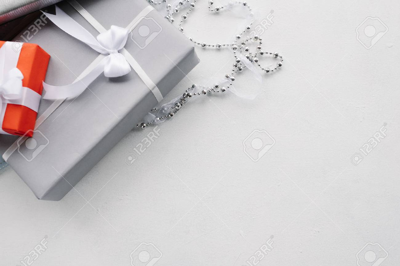 luxury jewelry gifts for top class on grey background. professional present wrapping for toffs on birthday, new year, christmas, thanksgiving, valentines day and other holidays. - 90318236