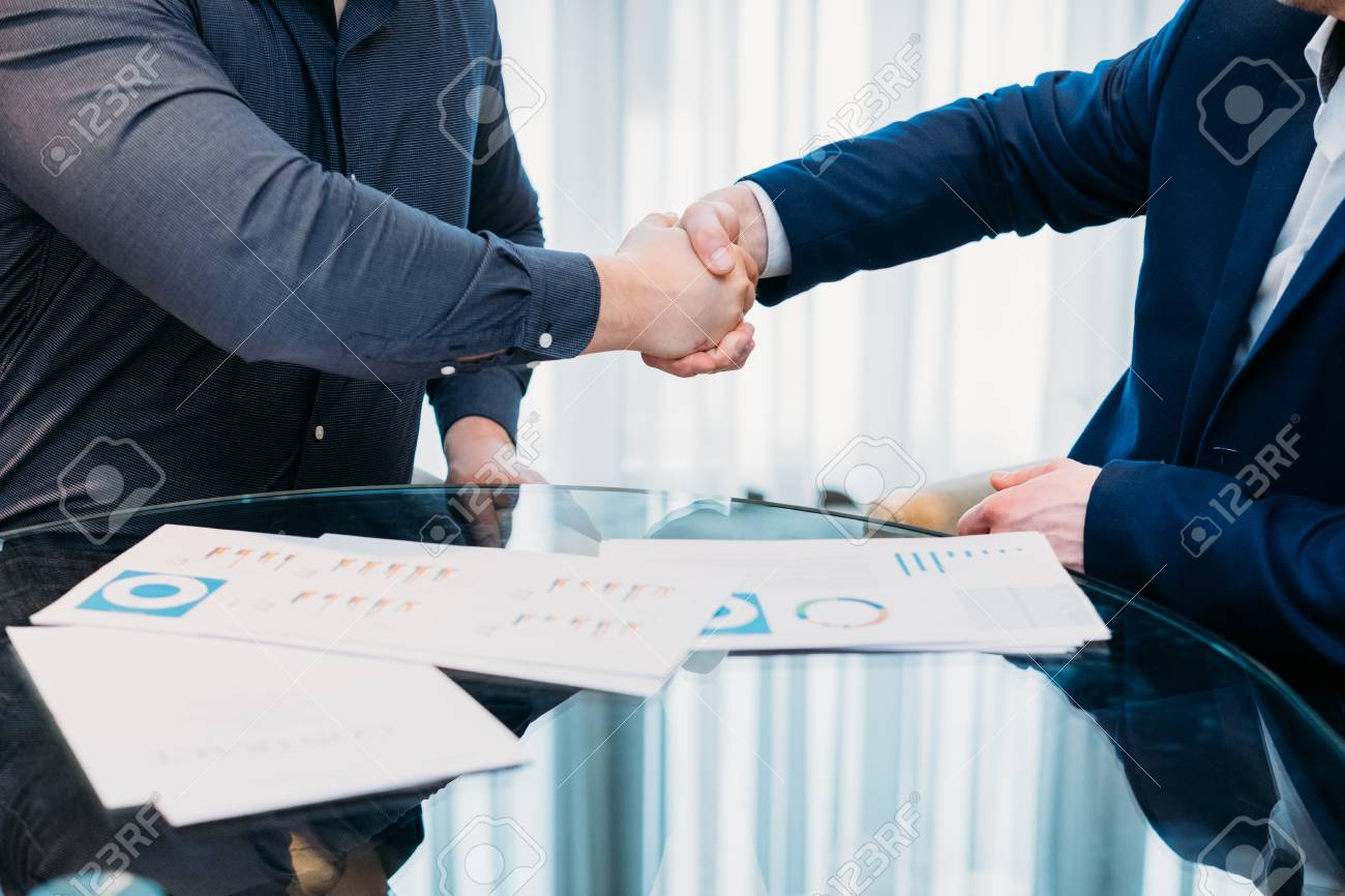 closing or sealing a deal. business partners shaking hands. cooperation partnership, trust joint venture concept - 100754077