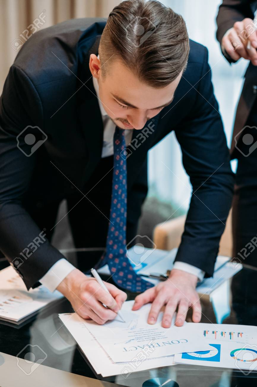Man Signing Contract Closeup Business Partnership And Cooperation - Partnership legal documents