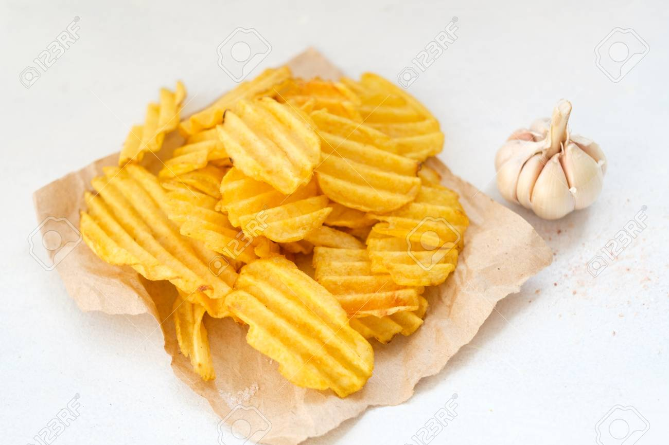 junk fast food and unhealthy eating. crispy chips. crunchy potato crisps on white background - 102494225