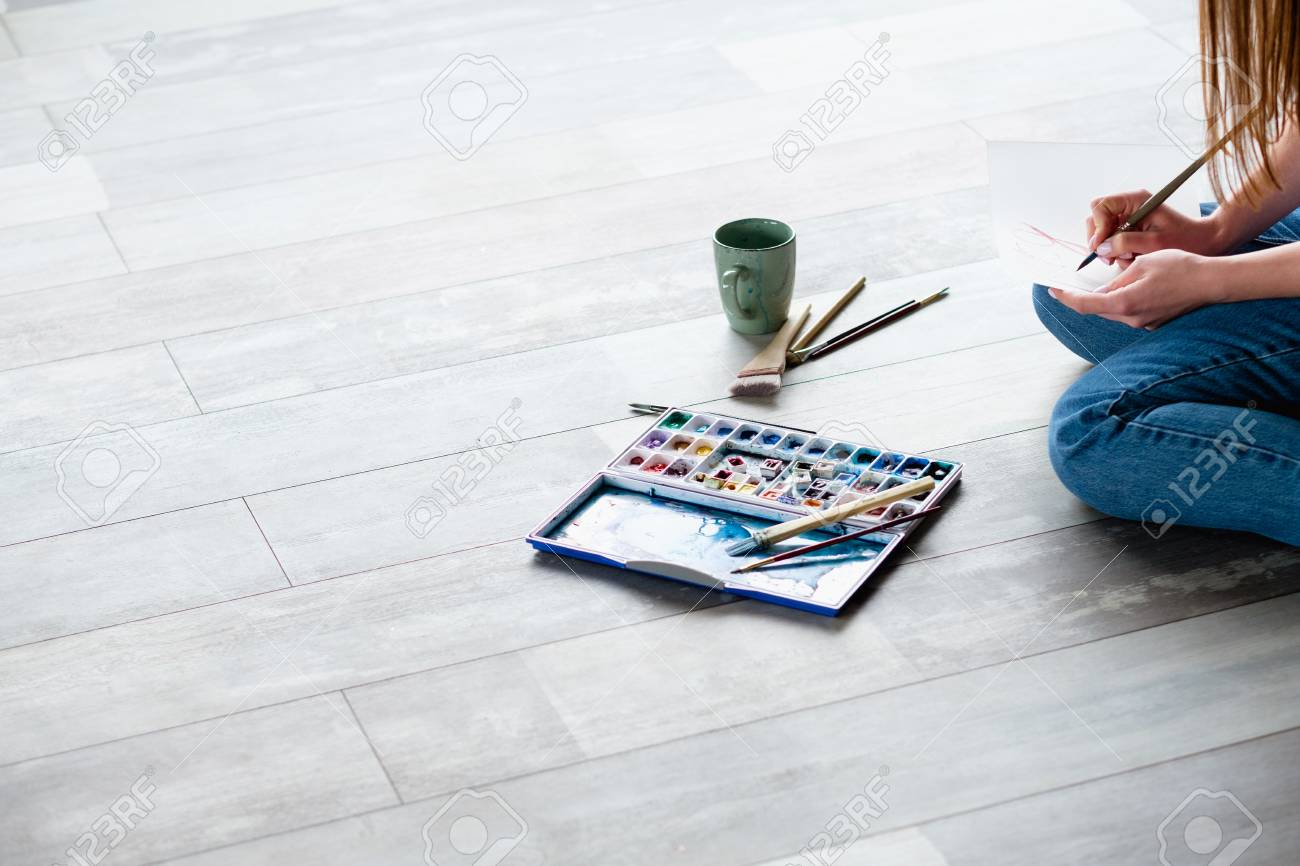creative leisure. painting hobby. artful personality. talented artist drawing sitting on the floor. - 105713607