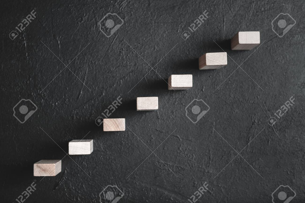Career growth and personal development. Future success and leadership. Achievement. Wooden blocks representing stairs. - 120173708