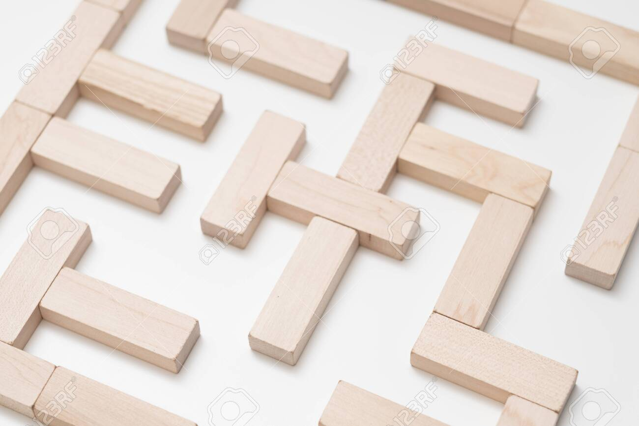 Logical thinking. Search for solution. Life quest. Business strategy. Conceptual maze construction with wooden block walls. - 120889652
