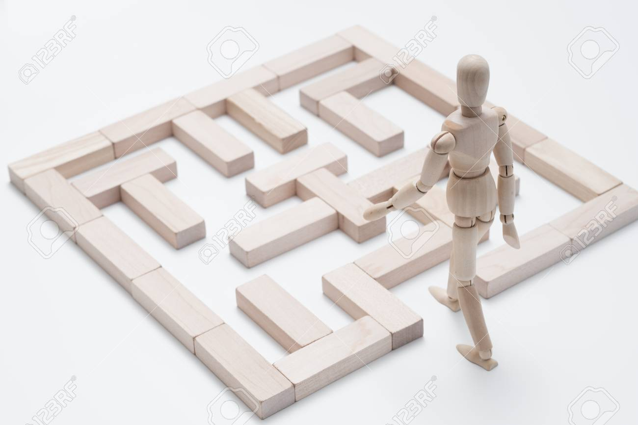 Encourage creativity. Think different. Dream big. Challenge. Blocks maze. Conceptual articulated mannequin composition - 120889810
