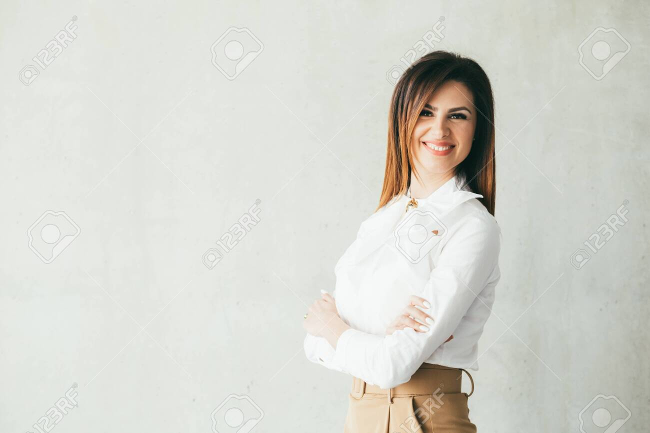 Successful business woman. Closeup portrait of smart, cheerful brunette young lady in formal outfit. Copy space. - 121138205