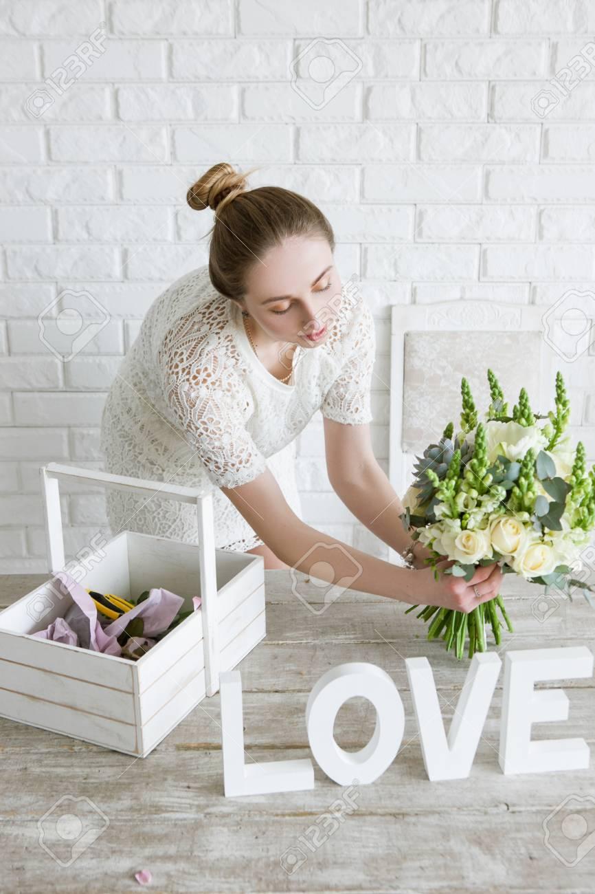 Florist show flower bouquet in shop young girl proposes to buy florist show flower bouquet in shop young girl proposes to buy a bridal bunch of izmirmasajfo