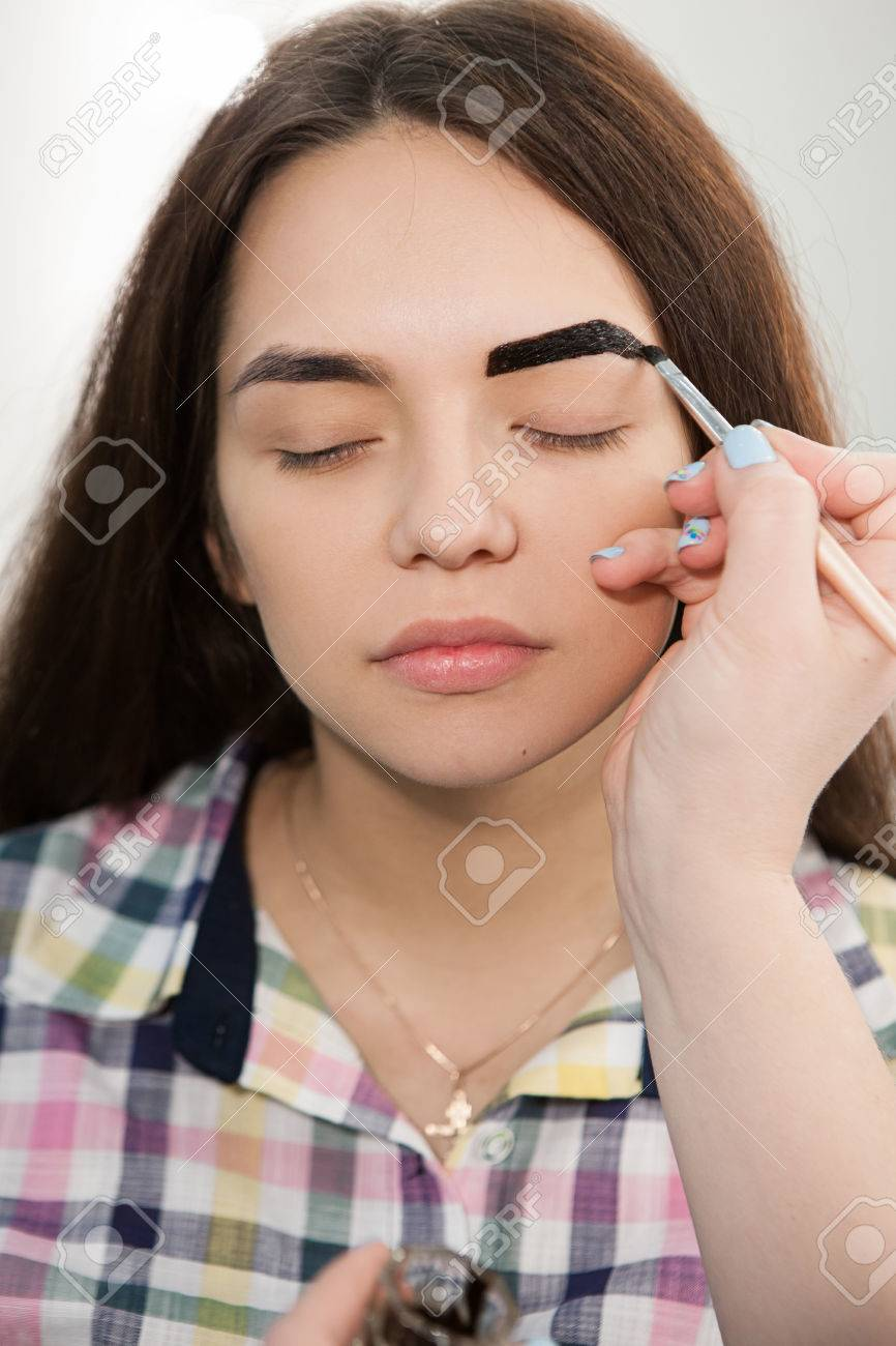 Beautician Is Coloring With Henna Brow Of Young Girl ...