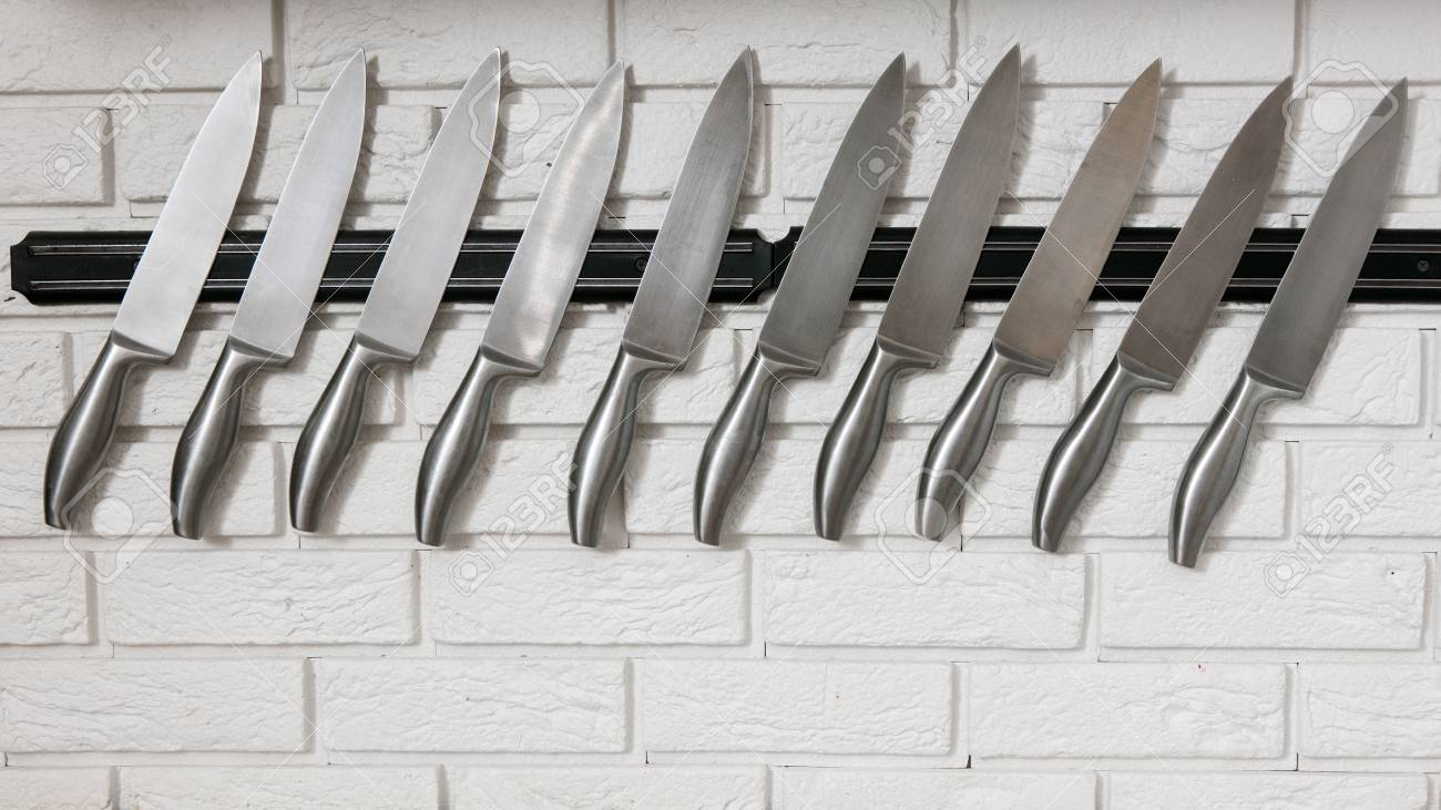Kitchen Knives Set On White Wall Many Silver Slicers Assortment