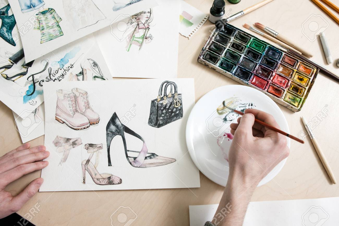 Fashion Designer Mixes Colours Of Paint In Process Of Drawing Stock Photo Picture And Royalty Free Image Image 83066928