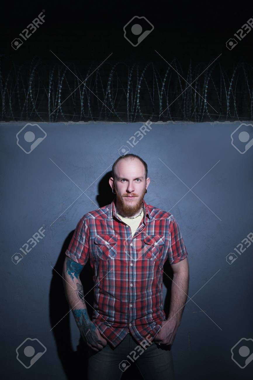 Confident Hipster Male On Barbed Wire Background. Strict Man.. Stock ...