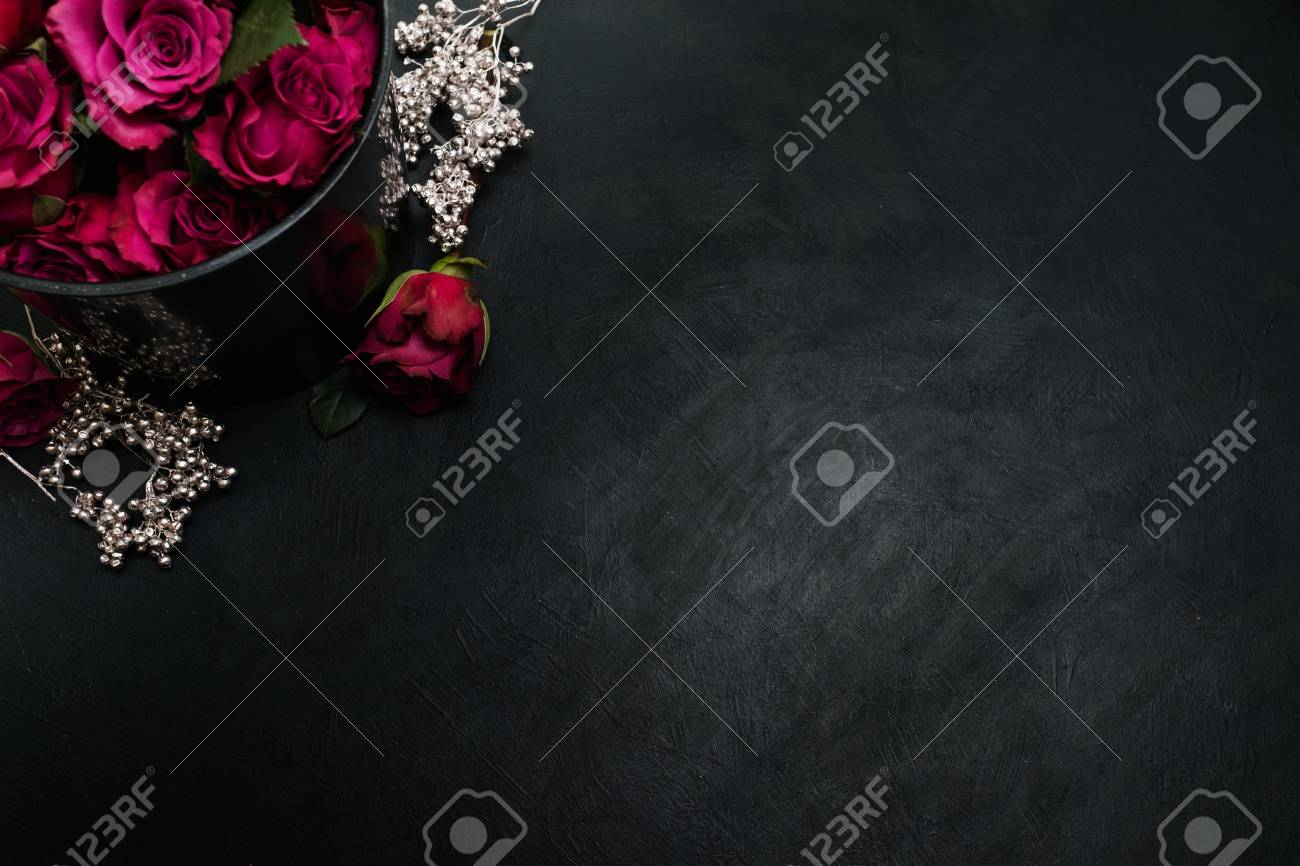 Burgundy Or Wine Red Roses And Silver Decor On Dark Background