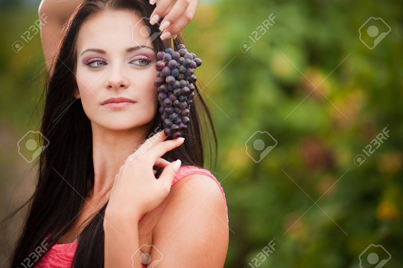 Portrait Of Young Beautiful Woman In Grapes