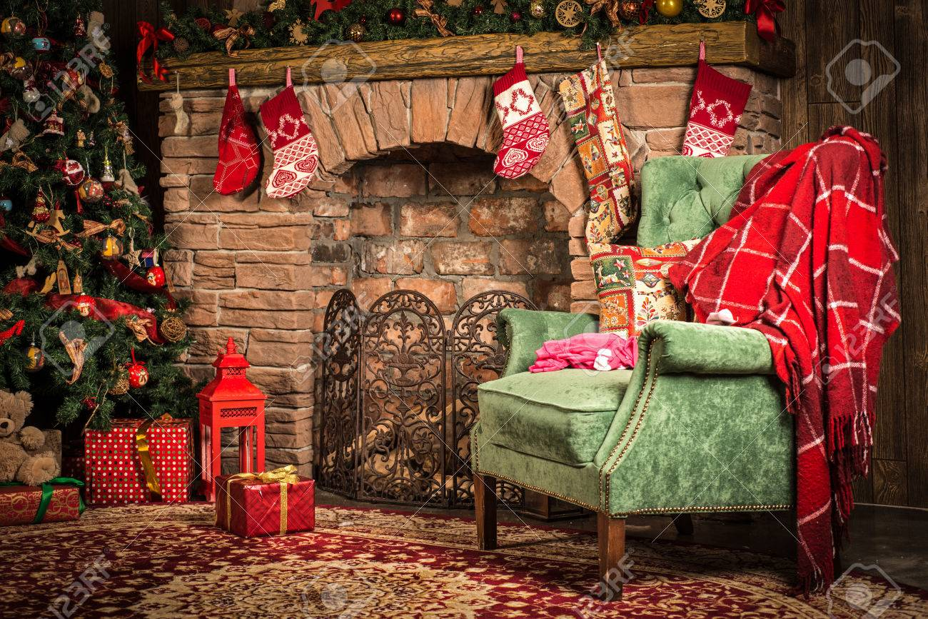 Interior Christmas Room: Fireplace, Chair And Tree Stock Photo   62318291