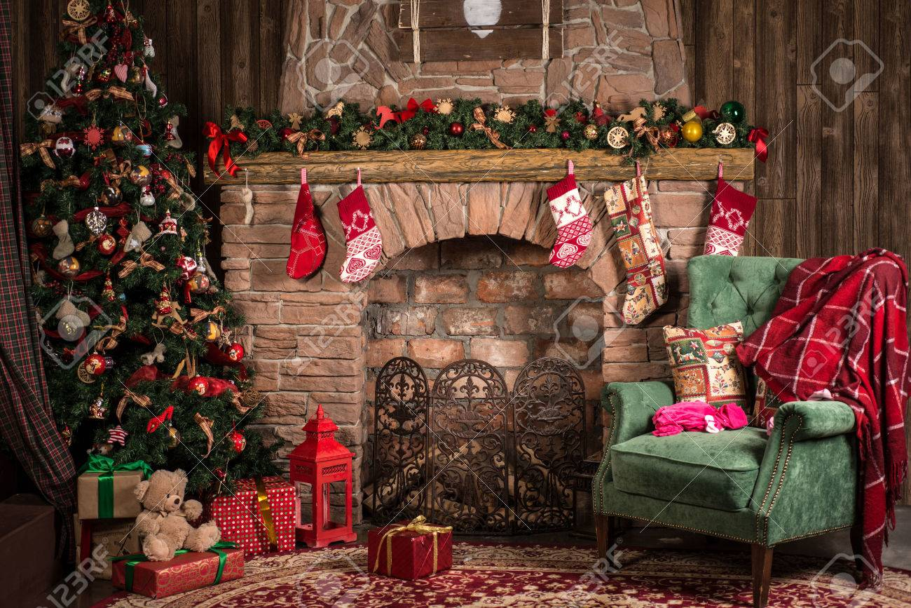 Interior Christmas room: fireplace, chair and tree - 62318294