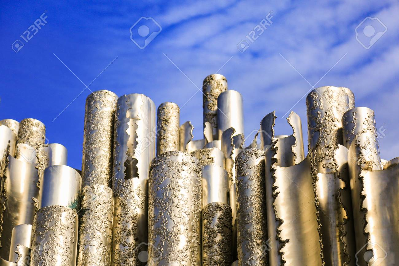 Hollow steel pipes welded together in wave-like pattern. Abstract concept art. Sibelius Monument in Helsinki, Finland. - 107239891