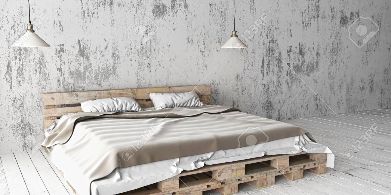 Una camera da letto in stile industriale con letto pallet riciclato. Lo  schema di eco design bianco è luminoso e minimalista.