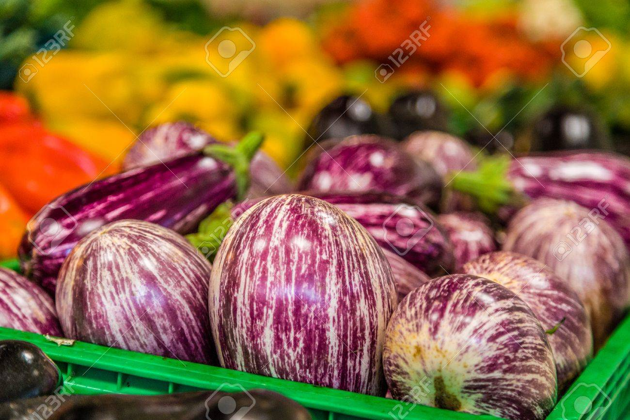 c527a19a57 Stock Photo - striped eggplant in green box for sale on the vegetable  counter