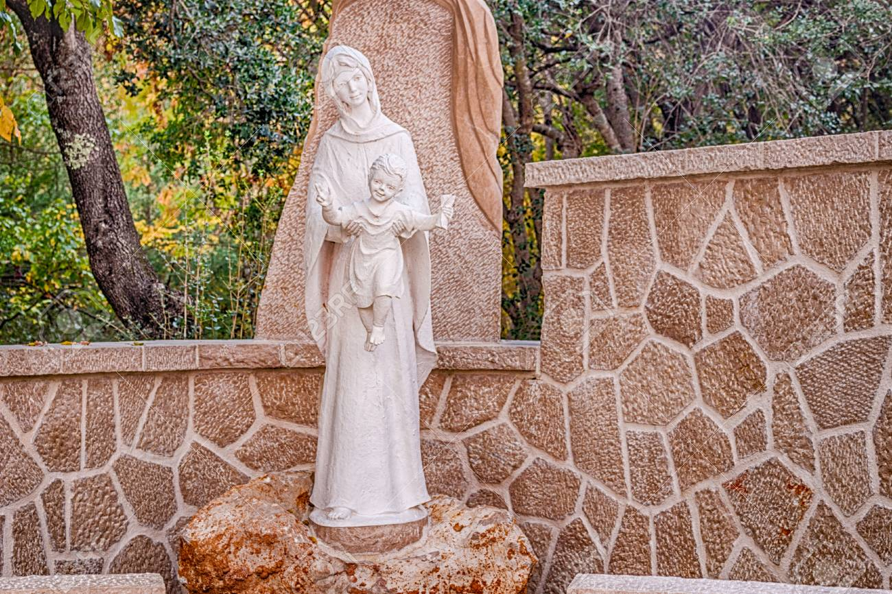 Statue Of The Blessed Virgin Mary With Baby Jesus In Rock Garden In  Medjugorje Stock Photo