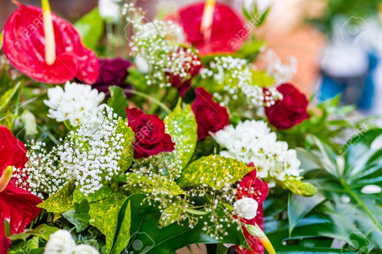 Bouquet Of Red And White Flowers With Green Leaves Stock Photo