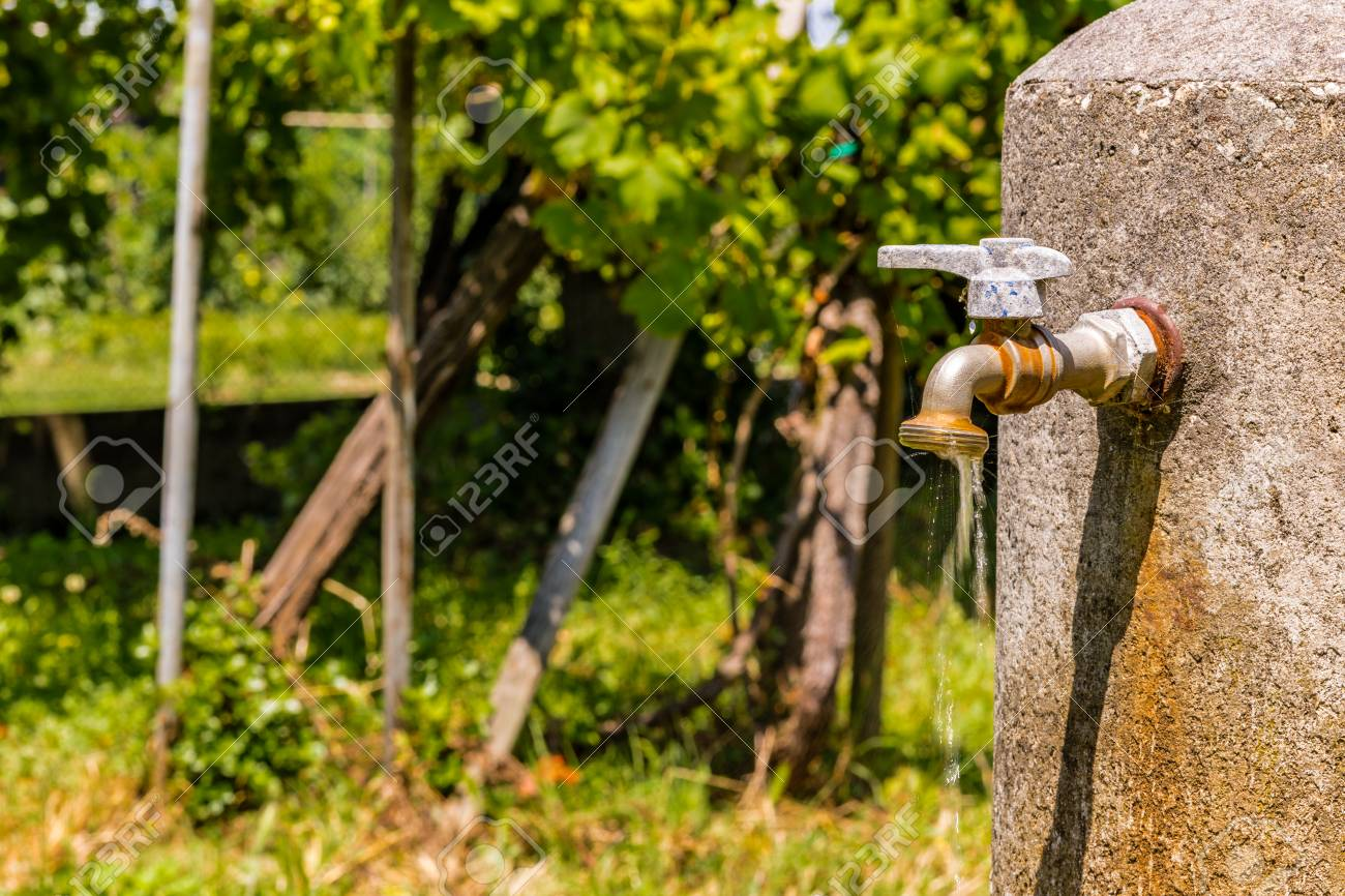Old Rusty Faucet Leaks, A Flow Of Water Is Coming Down Stock Photo ...