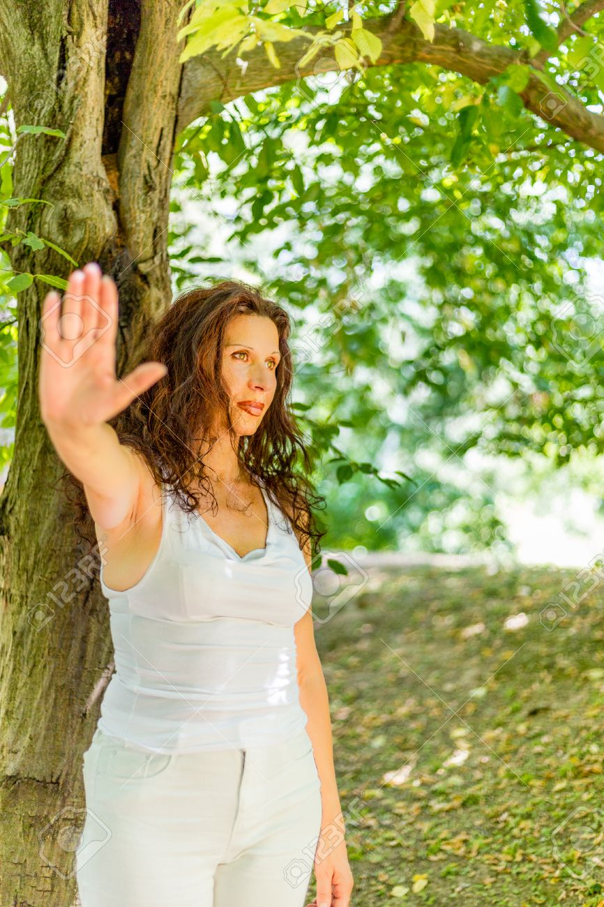 Stock Photo Stop And Talk To My Hand Gesture By Busty Classy Mature Woman With Negative Feelings Against Green Garden Background With Copy Space