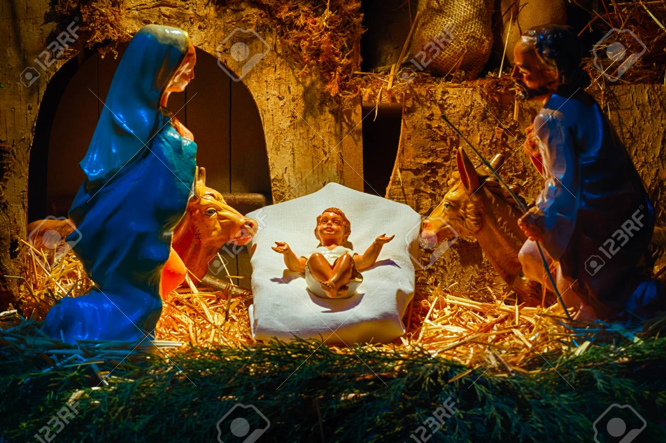 Christmas Nativity Scene Of Baby Jesus In The Manger With Saint ...