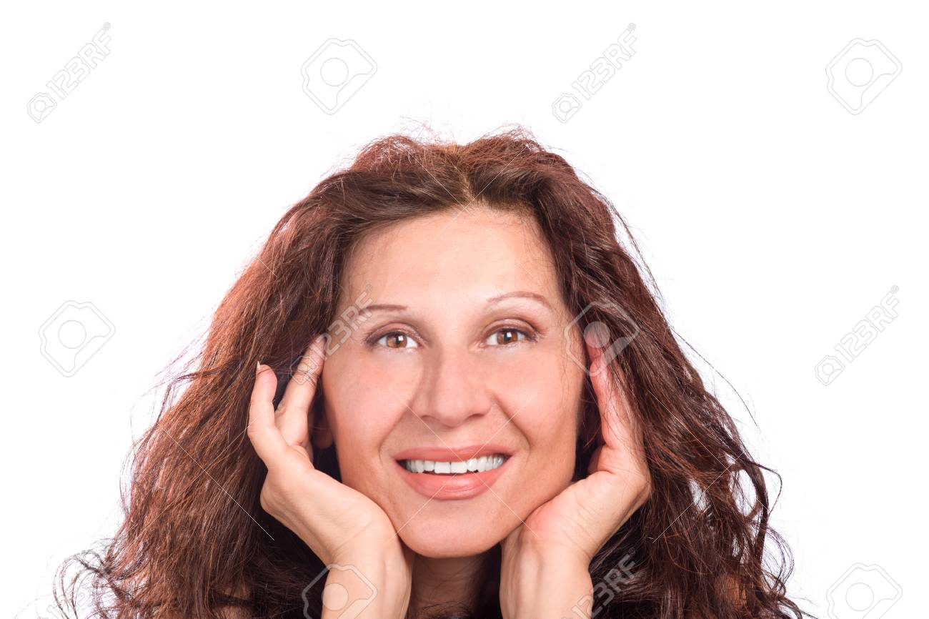 mature woman smiling and holding chin with hands, caucasian but