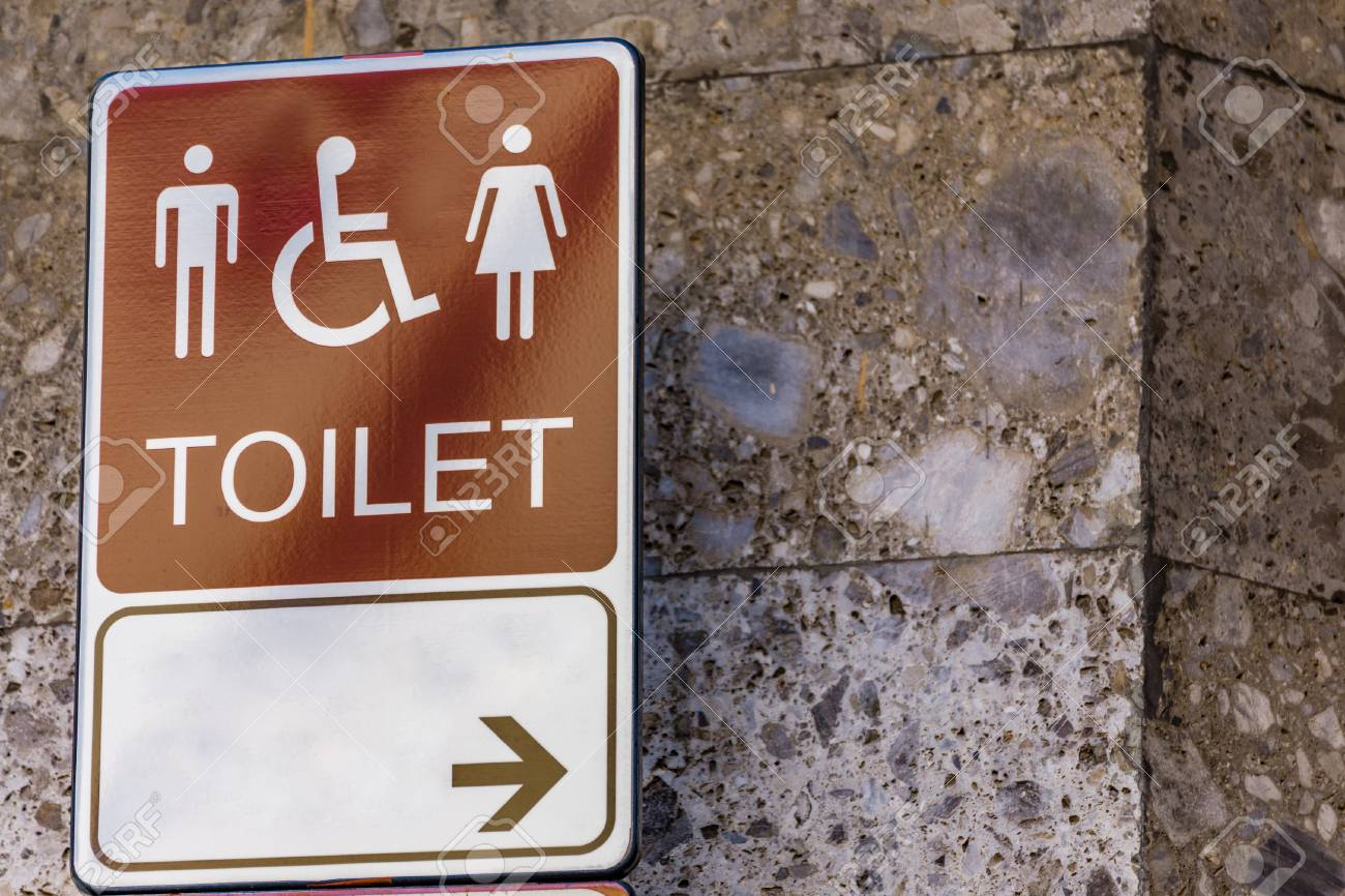 Public restroom signs on old marble wall stock photo 95957703