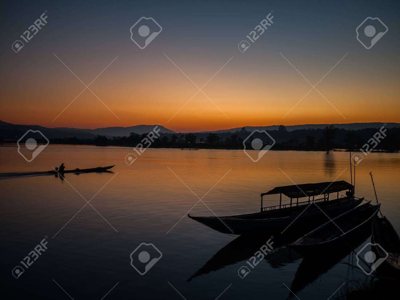 silhouette of fishing boat in Mekong river Stock Photo - 16964800