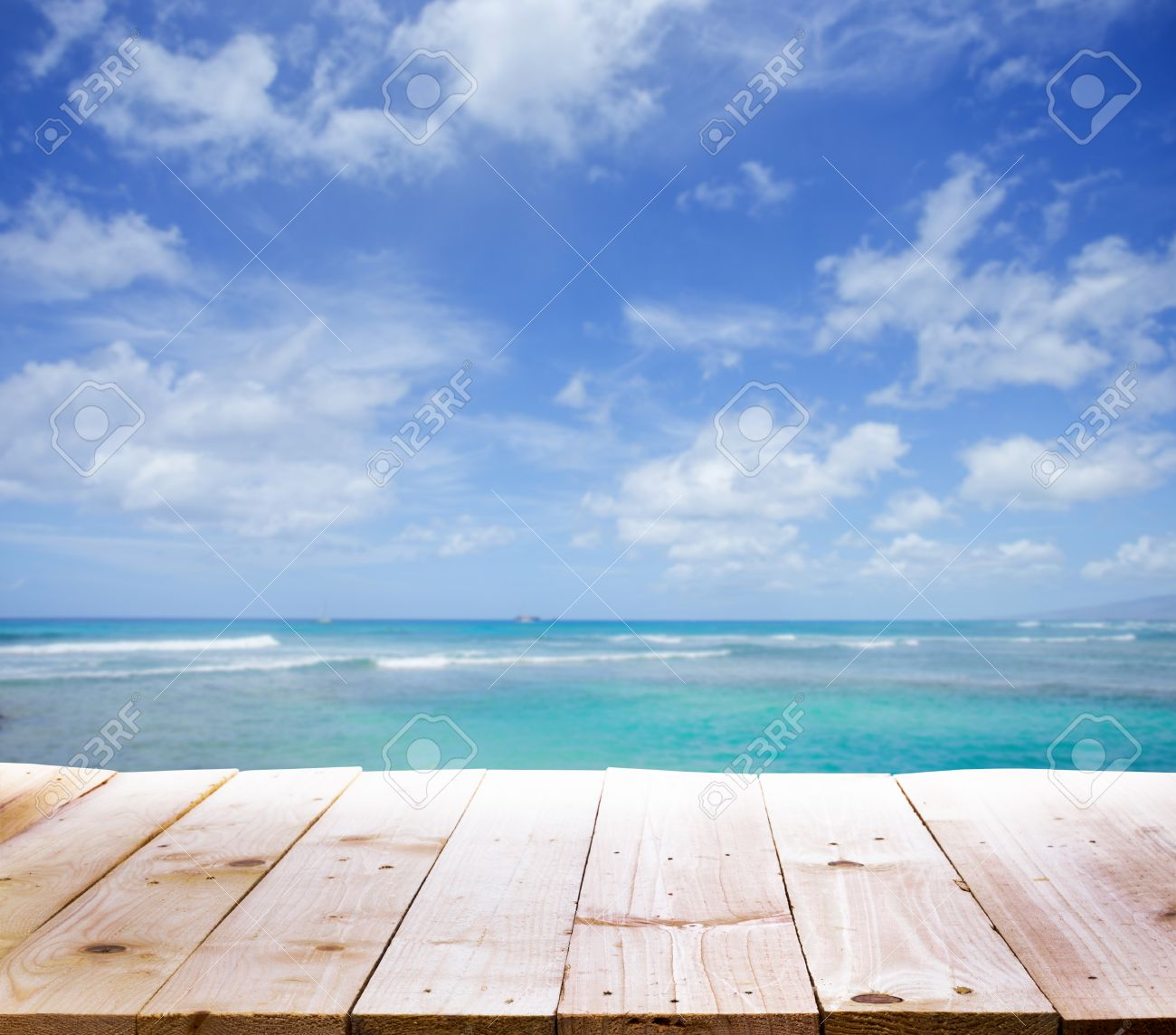 Stock Photo - Wood table with sea background