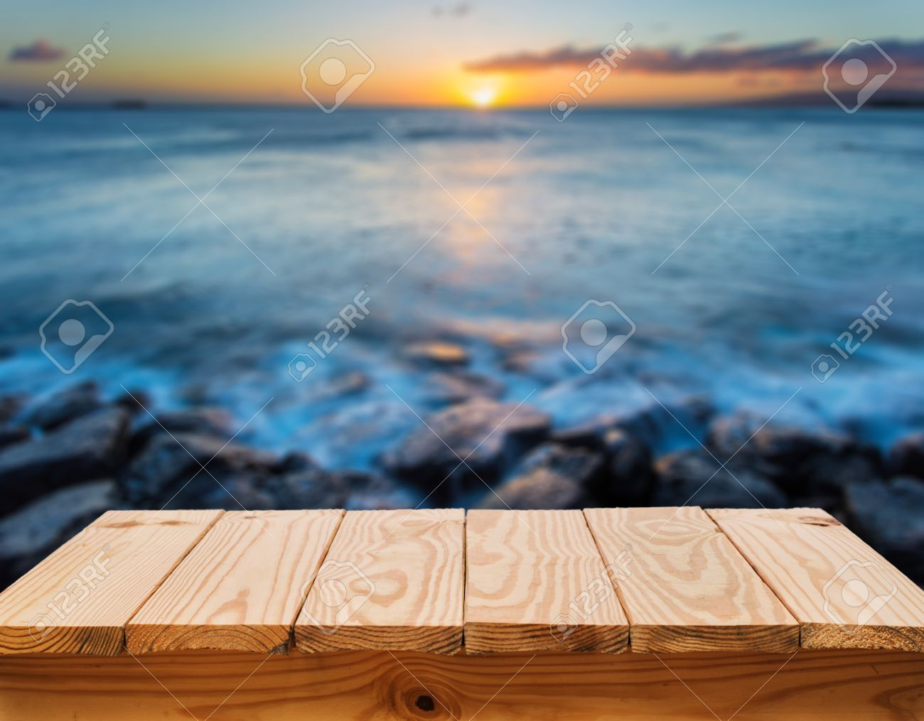 Wood table and sunset beach background