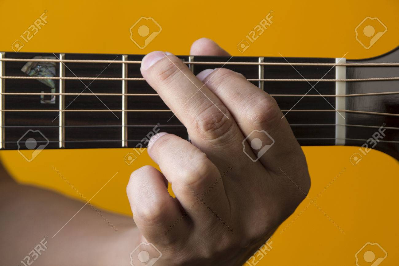 Hand Performing G Chord On Guitar Stock Photo Picture And Royalty