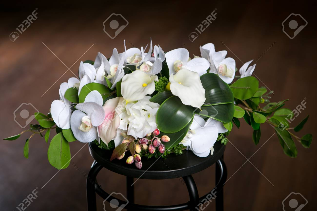 Bouquet Of Beautiful Mixed Flowers In Vase On A Dark Background