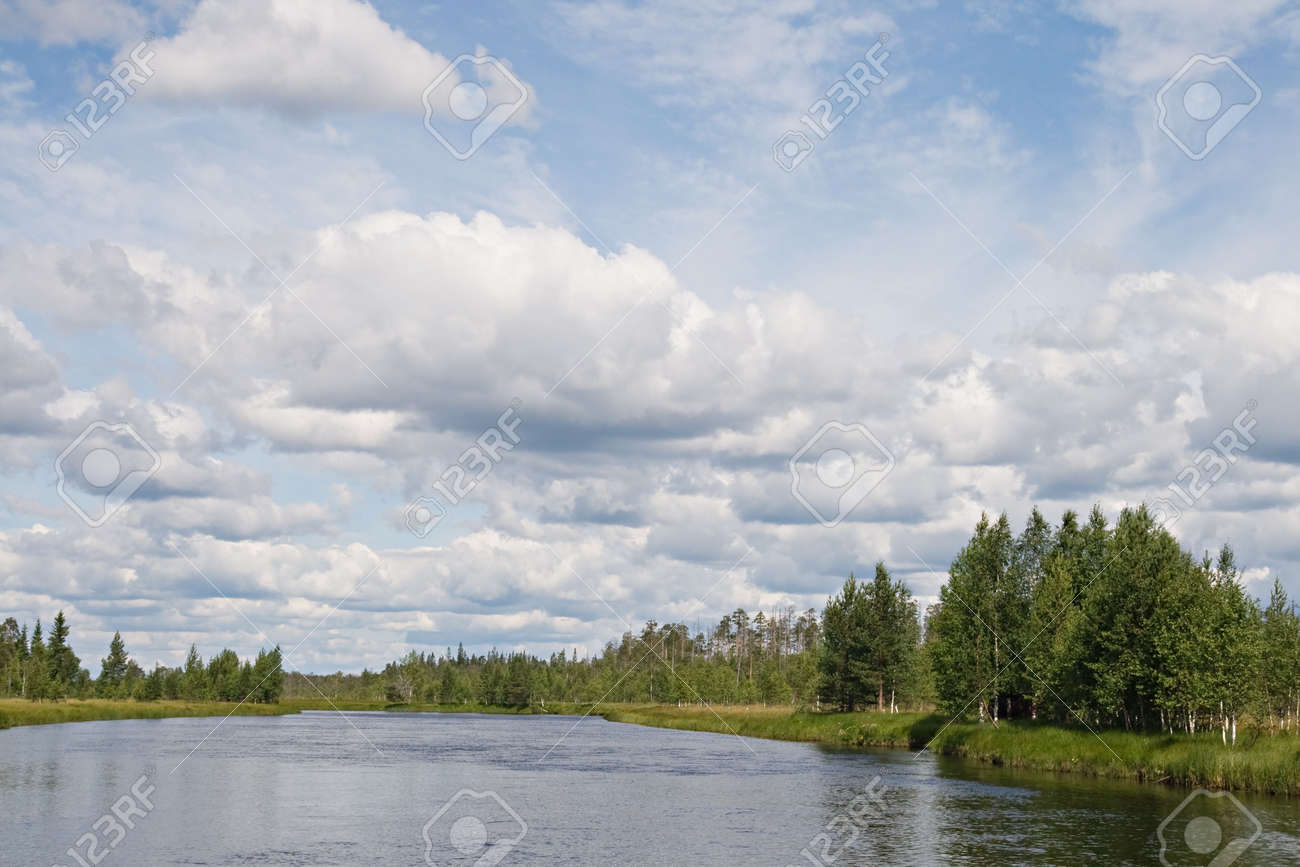 Landscape of Karelian lake and sky with clouds Stock Photo - 4429333