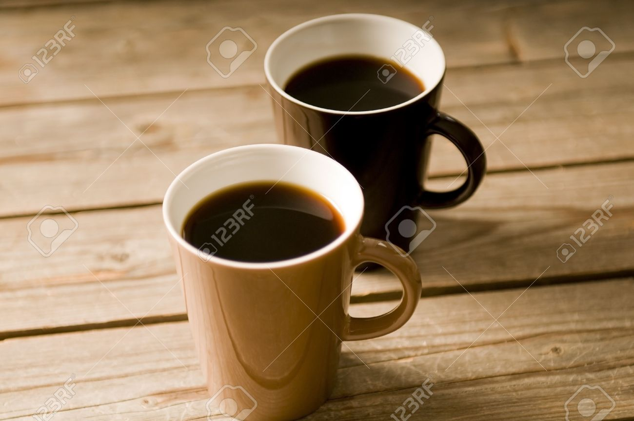Two Cups of coffee on a wooden table, with shallow DOF Stock Photo - 3111915