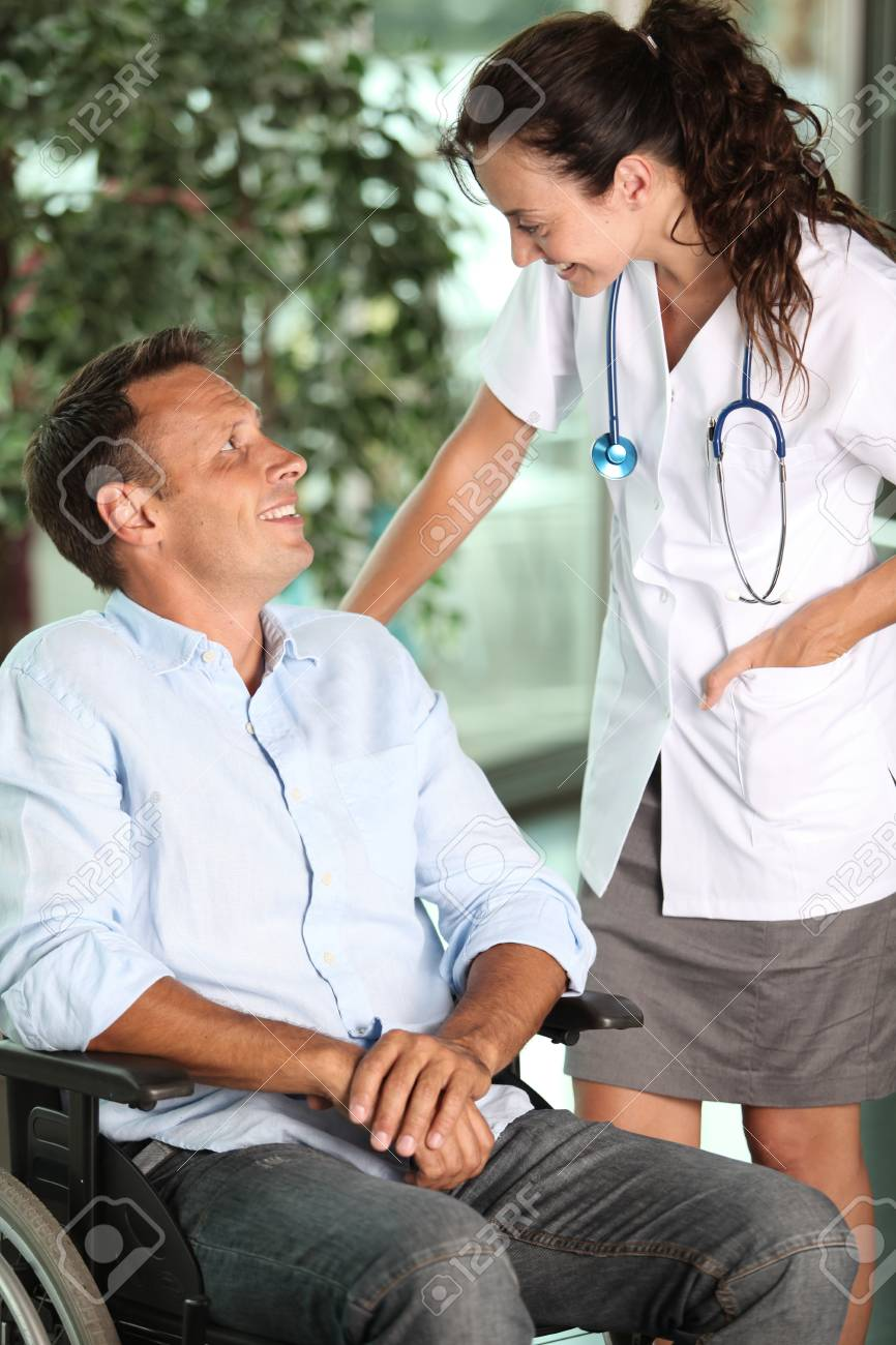 Man in wheelchair with doctor Stock Photo - 7524798
