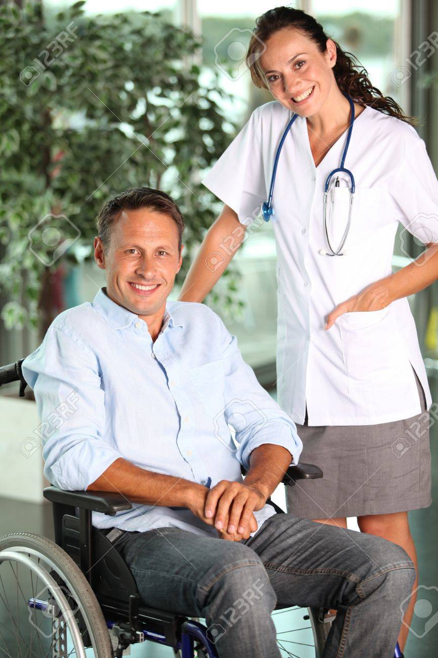 Man in wheelchair with doctor in hospital Stock Photo - 7577813