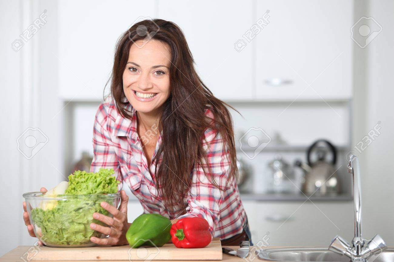 Beautiful woman stading in kitchen Stock Photo - 7953937