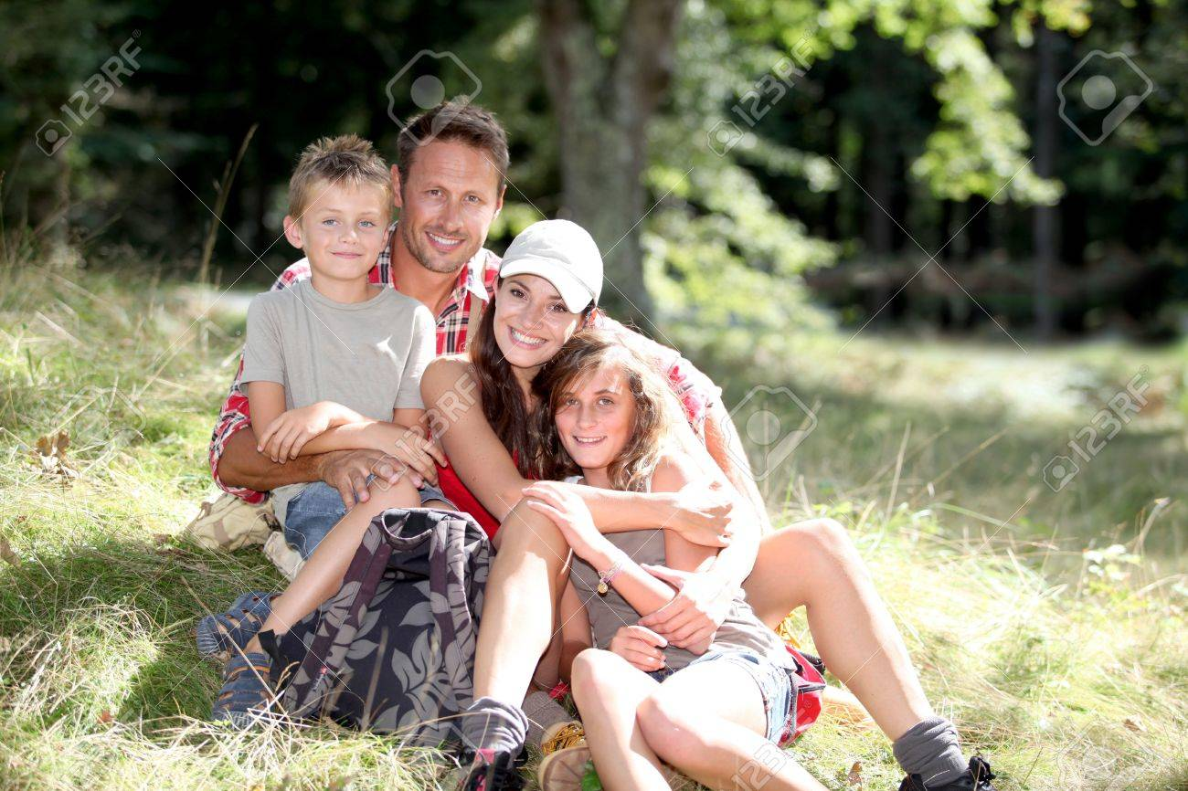 Family sitting in nature on a hiking day Stock Photo - 7954152