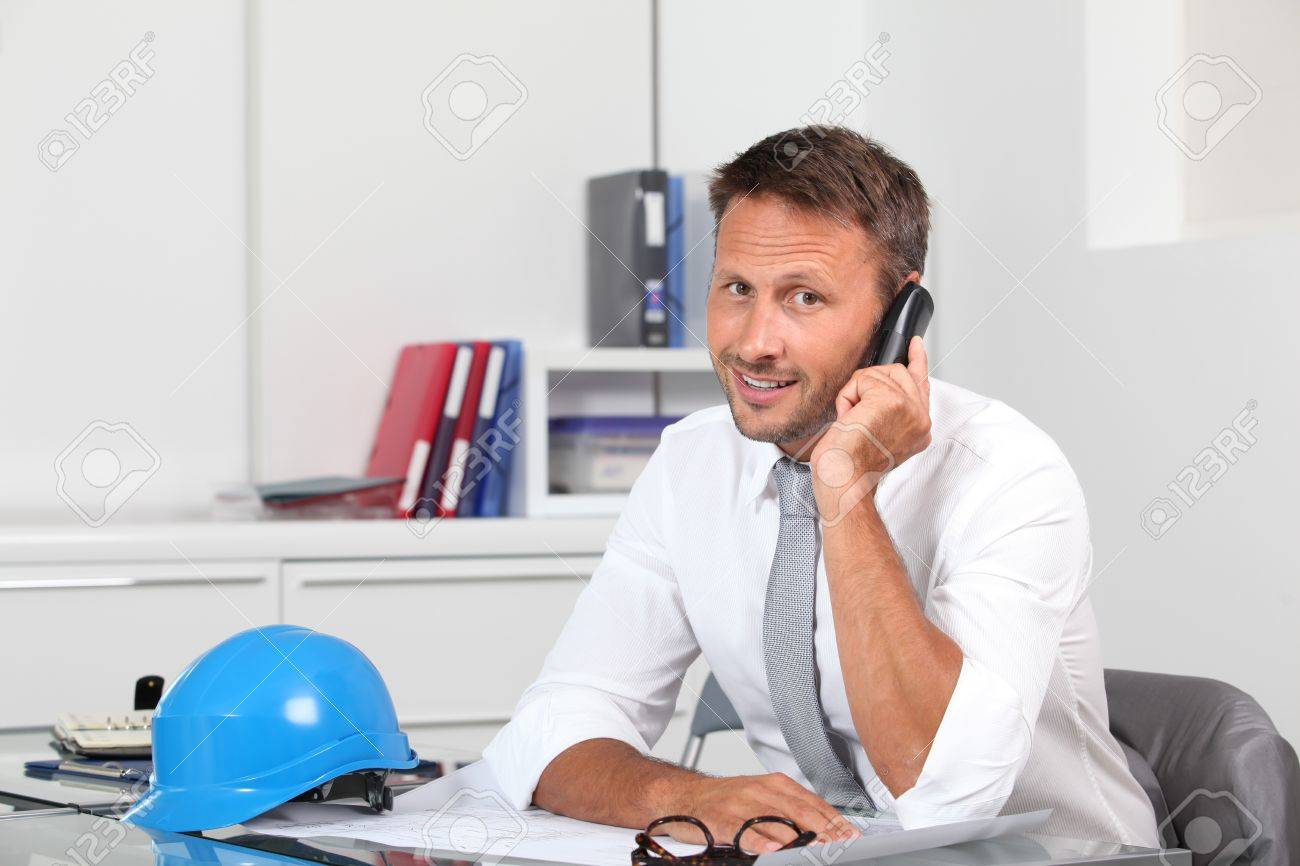Site manager in the office with blue helmet Stock Photo - 7954042