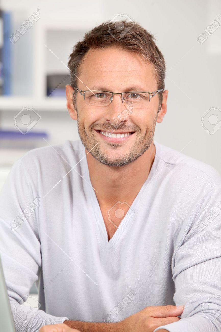 632518e3b2e Portrait of handsome man wearing eyeglasses Stock Photo - 7954070