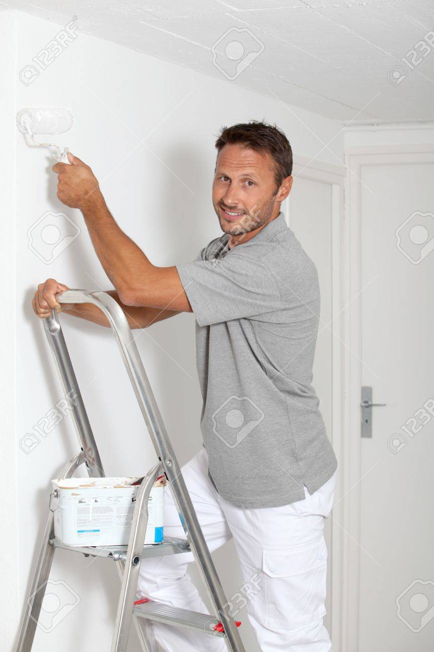 Man painting walls in white Stock Photo - 7954550