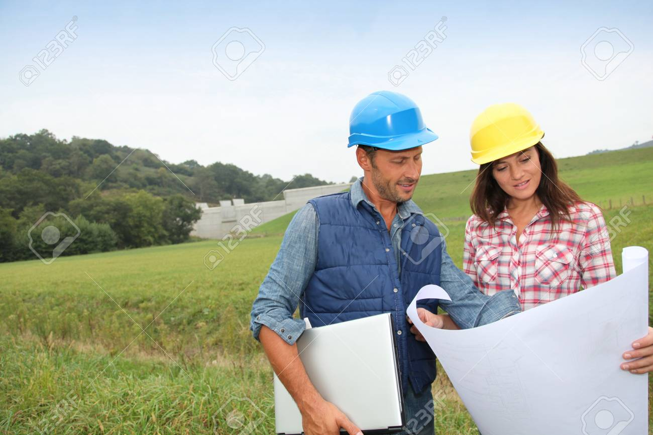 Business people checking plan on construction site Stock Photo - 7954343