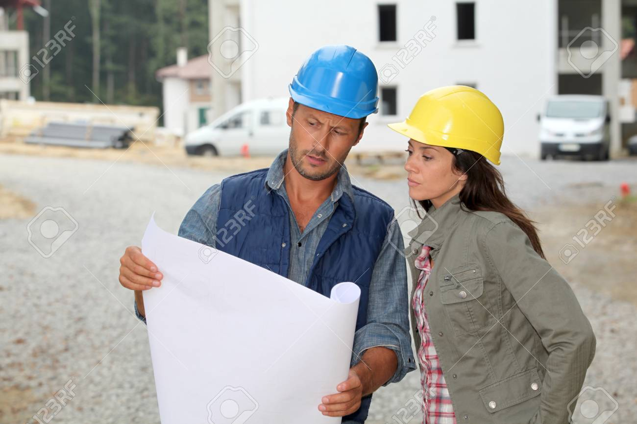 Team of architects checking plans on site Stock Photo - 7954310