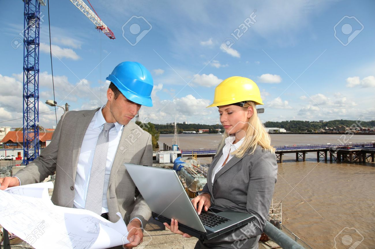 architect and supervisor checking site under construction stock