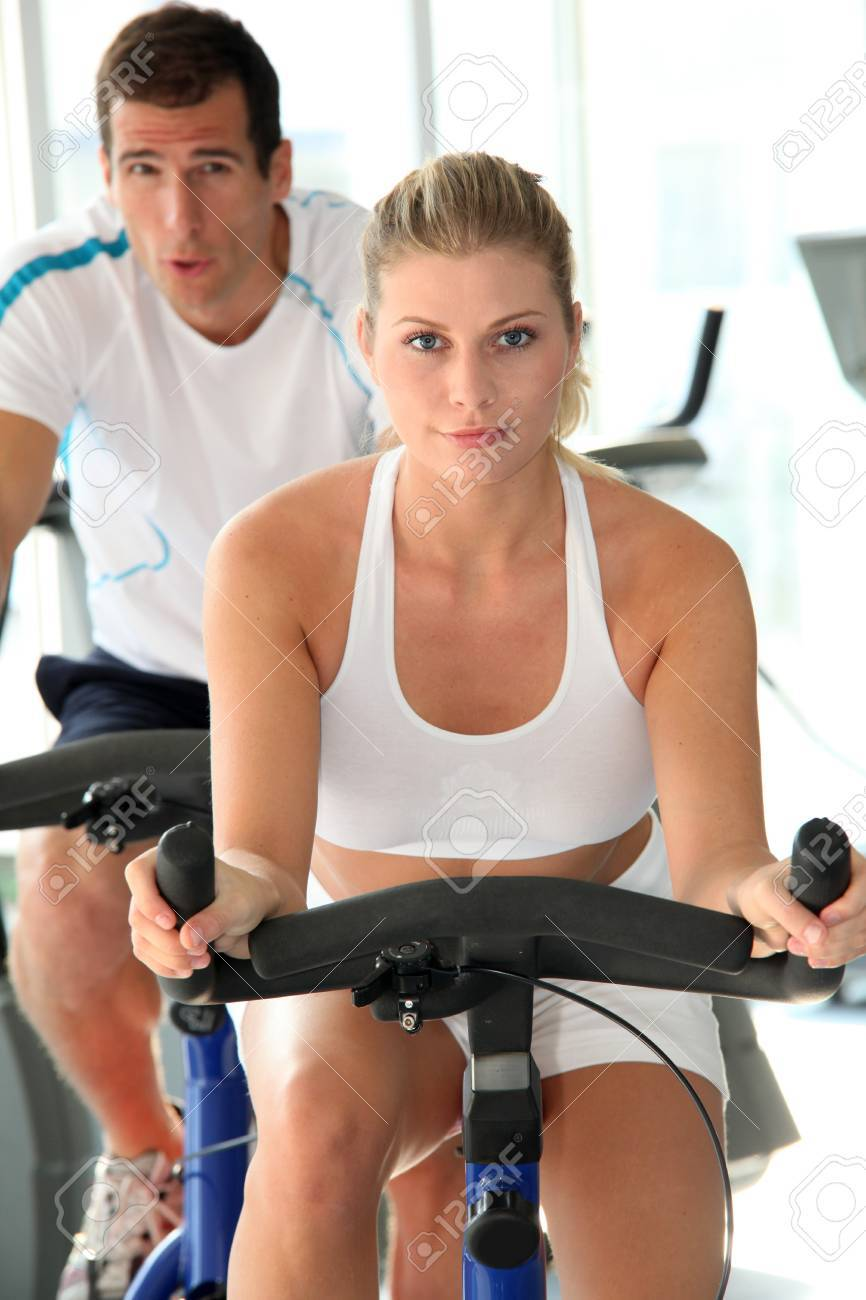 Man and woman doing indoor biking Stock Photo - 8088510