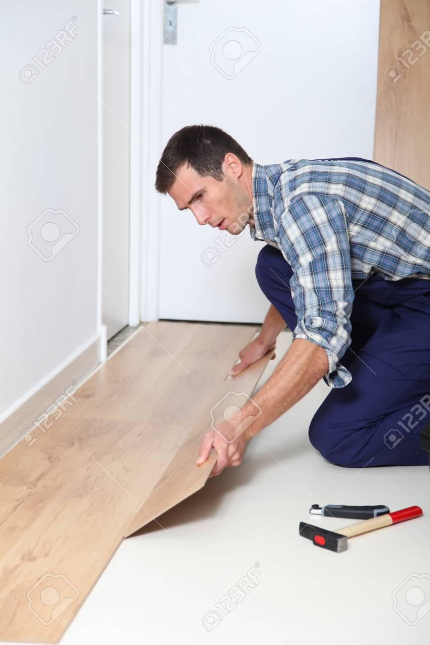 Closeup of artisan installing flooring in room Stock Photo - 8088381
