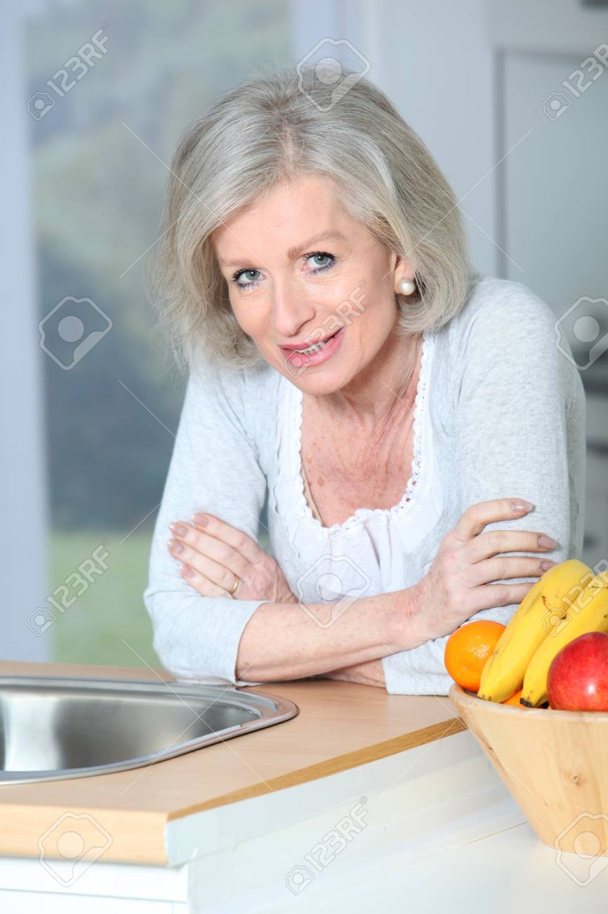Senior woman standing in kitchen Stock Photo - 8400911