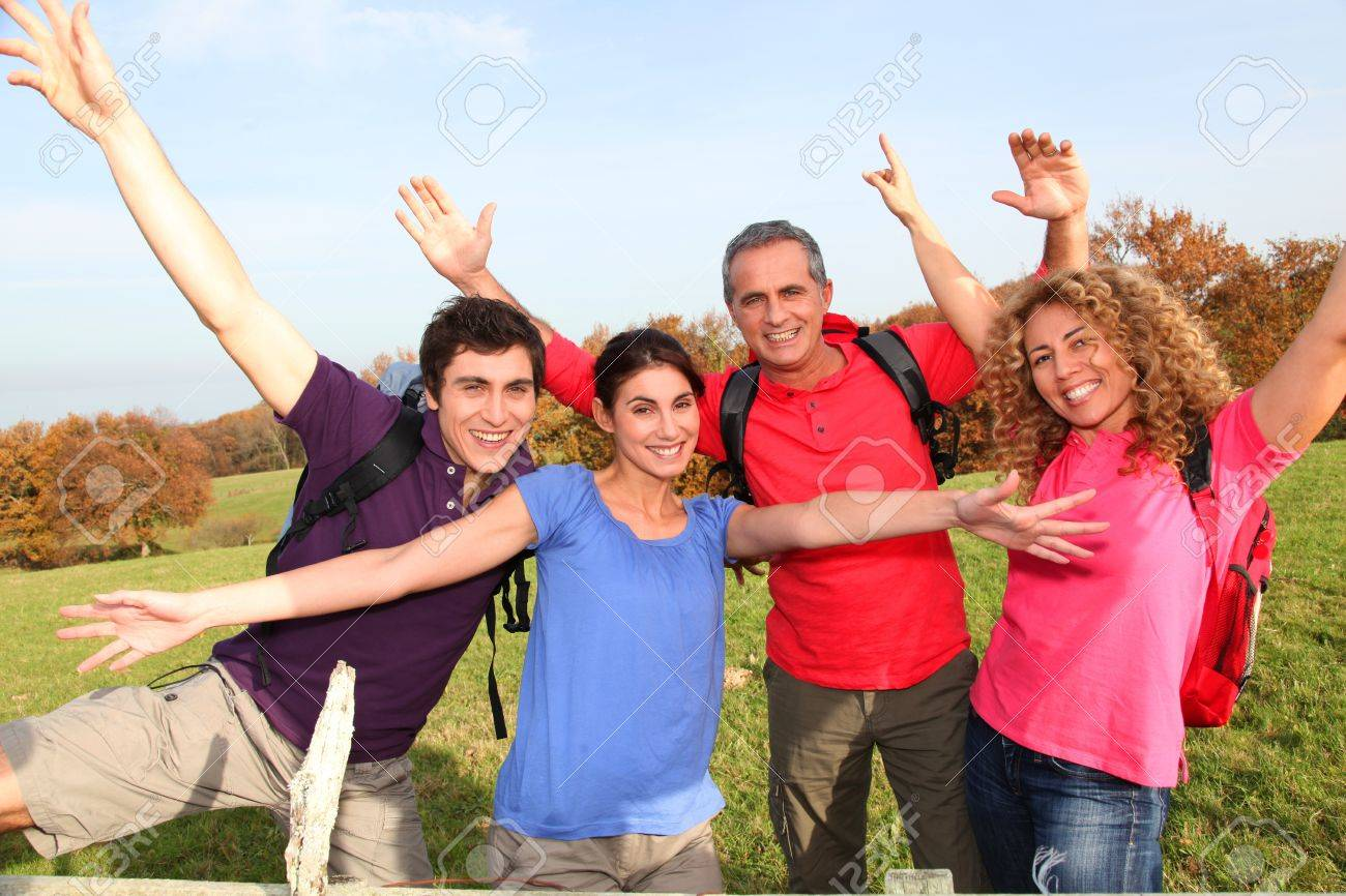 Group of friends hiking in countryside Stock Photo - 8742842