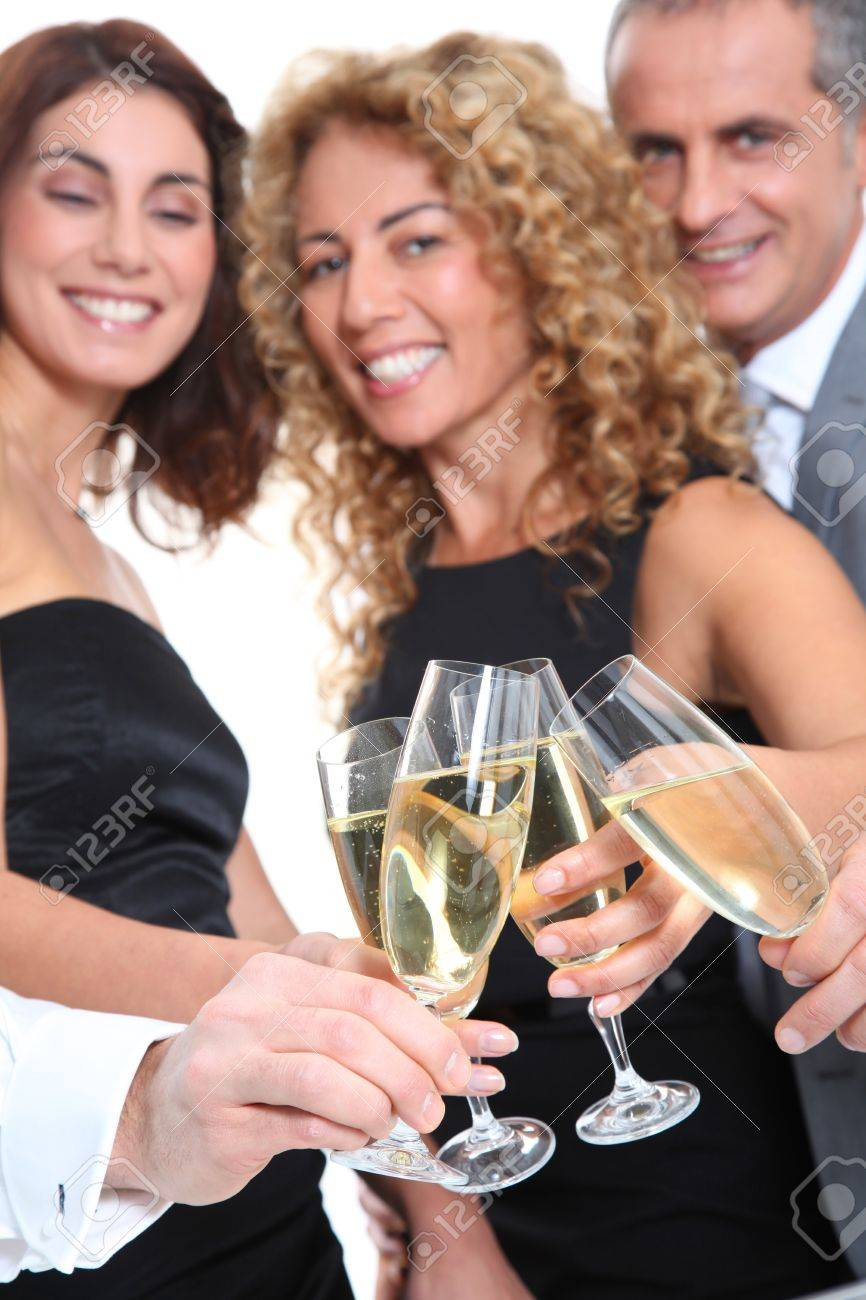 Group of friends cheering with glasses of champagne Stock Photo - 8740576